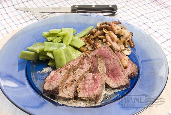 Steak met spekjes en champignons