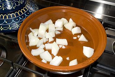 Tajine van lamszadel (of lamskoteletten), pompoen en kruiden